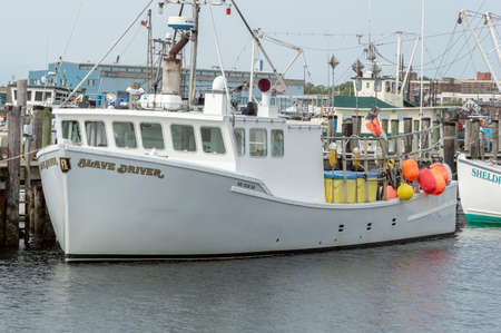 New Bedford, Massachusetts, USA - May 18, 2018: Commercial fishing vessel Slave Driver moored at Pope's Island in New Bedford