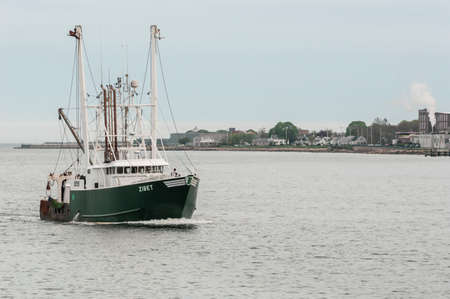 New Bedford, Massachusetts, USA - May 17, 2018: Commercial fishing vessel Zibet, approaching New Bedford from Buzzards Bay