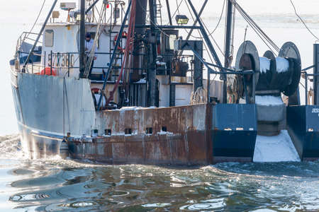 New Bedford, Massachusetts, USA - January 10, 2018:  Commercial fishing boat Jessica & Susan heading out across New Bedford outer harbor