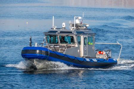 New Bedford, Massachusetts, USA - March 1, 2018: Massachusetts State Police Defender class patrol boat crossing New Bedford inner harbor