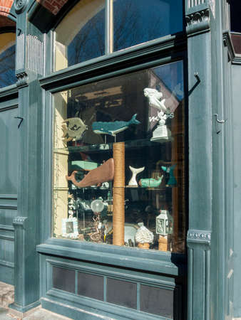 New Bedford, Massachusetts, USA - March 10, 2018: Whaling oriented art displayed in window of small New Bedford gallery