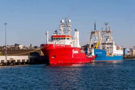 New Bedford, Massachusetts, USA - May 13, 2020: Survey vessels Fugro Searcher and Gardline Ocean Observer docked at Marine Commerce Terminal Redactioneel