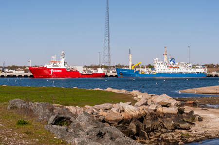 New Bedford, Massachusetts, USA - May 13, 2020: Colorful offshore survey vessels Fugro Searcher and Gardline Ocean Observer docked at Marine Commerce Terminal