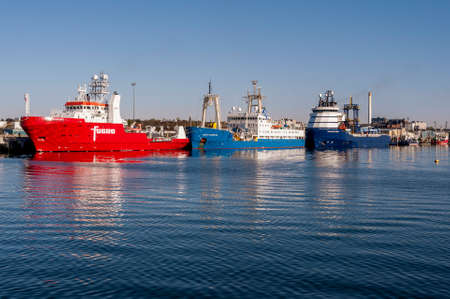 New Bedford, Massachusetts, USA - May 14, 2020: Early morning sun reflecting off geotechnical research vessels docked at Marine Commerce terminal