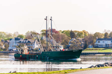New Bedford, Massachusetts, USA - May 14, 2020: Commercial fishing boat Bountiful II nearing hurricane barrier on her way to go fishing