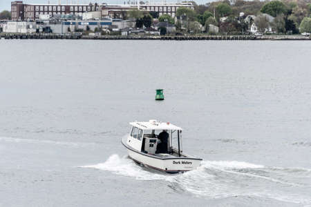 New Bedford, Massachusetts, USA - May 16, 2020: Lobster boat Dark Waters, hailing port Padanaram, MA, outbound from New Bedford Redactioneel