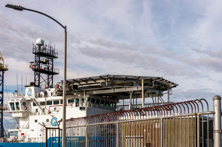 New Bedford, Massachusetts, USA - May 16, 2020: Superstructure of Geoquip Saentis, a 250-foot research vessel equipped with a drill rig and helipad, transiting New Bedford hurricane barrier. Redactioneel