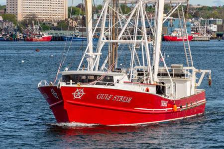 New Bedford, Massachusetts, USA - May 16, 2020: Commercial fishing boat Gulf Stream, hailing port Beaufort, NC, crossing New Bedford inner harbor