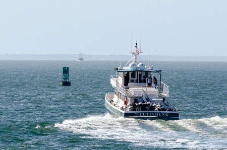 New Bedford, Massachusetts, USA - May 11, 2020: Cuttyhunk Ferry heading into hazy, choppy Buzzards Bay