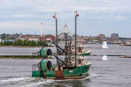 New Bedford, Massachusetts, USA – October 2, 2019: Trawler Hercules crossing New Bedford inner harbor