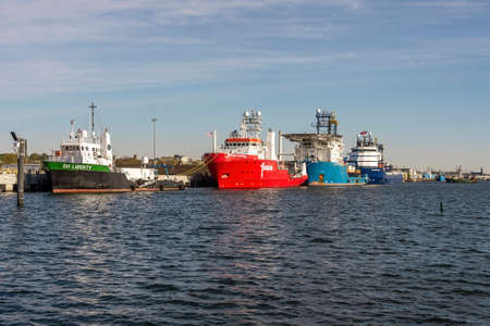 New Bedford, Massachusetts, USA - May 20, 2020: Go Liberty, Fugro Searcher, Geoquip Saentis and Kommandor Susan strung out along dock at Marine Commerce Terminal