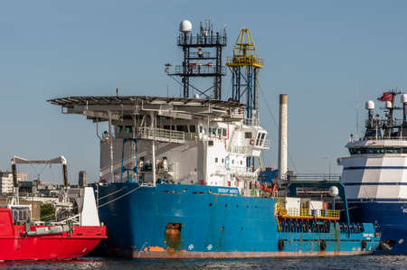 New Bedford, Massachusetts, USA - May 20, 2020: Marine surveying vessel Geoquip Saentis sandwiched between other survey boats docked at Marine Commerce Terminal
