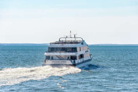 New Bedford, Massachusetts, USA - May 20, 2020: High-speed ferry Nantucket Express accelerates toward Buzzards Bay on early season run Editorial