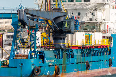 New Bedford, Massachusetts, USA - May 16, 2020: Massive crane aboard Geoquip Saentis, a 250-foot research vessel equipped with a drill rig and helipad