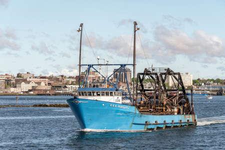 New Bedford, Massachusetts, USA - June 4, 2020: Commercial fishing boat E.S.S. Pursuit going fishing