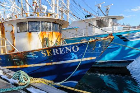 New Bedford, Massachusetts, USA - March 15, 2018: Fishing boat Sereno waiting alongside pier on Acushnet River