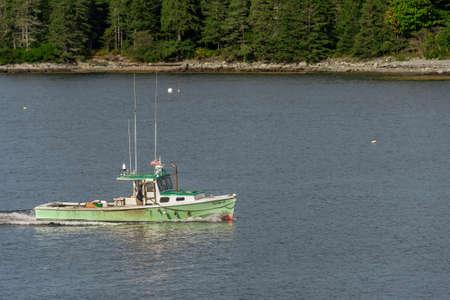 Bass Harbor, Maine, USA - September 21, 2018: Lobster boat Elsie-V returning to Bass Harbor