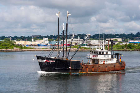 New Bedford, Massachusetts, USA - July 1, 2020: Eastern-rig fishing boat Leader, hailing port Cape May, NJ, leaving New Bedford on fishing trip