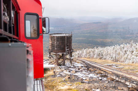 Mount Washington, New Hampshire, USA - October 2, 2009: Cog Railway diesel locomotive passes water tank used by steam locomotives to refuel on their way up the mountain Redakční