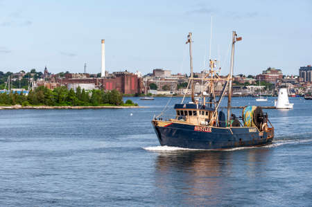 New Bedford, Massachusetts, USA - July 7, 2020: Trawler Hustler heading out of New Bedford