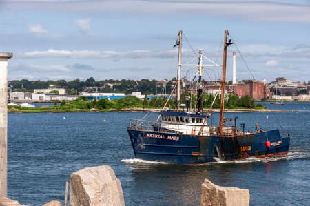New Bedford, Massachusetts, USA - July 11, 2020: Commercial fishing boat Krystal James, hailing port Westport, Maine, crossing New Bedford outer harbor