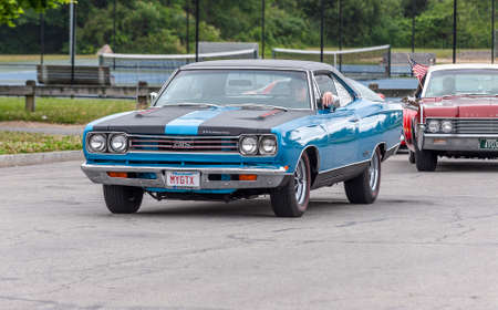 Fairhaven, Massachusetts, USA - July 4, 2020: Plymouth GTX muscle car passing Fort Phoenix during Fairhaven Fourth of July Car Cruise