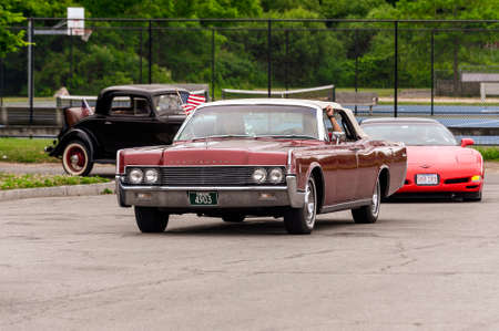Fairhaven, Massachusetts, USA - July 4, 2020: Lincoln Continetal convertible passing Fort Phoenix during Fairhaven Fourth of July Car Cruise Redakční