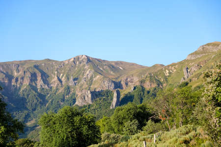 Landscape of the Massif du Sancy in the chain of puys in Auvergne. Mountains, summer pastures, mountain pastures and rocks in France. 写真素材