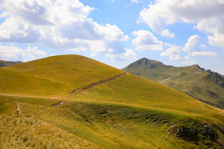 Mountains, hills and meadows during the summer in Auvergne. Summer pastures and mountain pastures in France. Landscape of the Massif du Sancy in the chain of puys in Auvergne, France. 写真素材