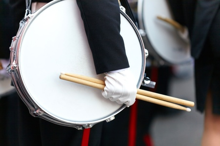 Drum with a hand and drumsticks on parade closeup Stock Photo - 11466990