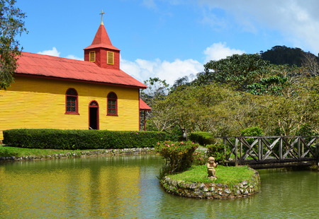A brightly painted church in the countryside. Stock Photo