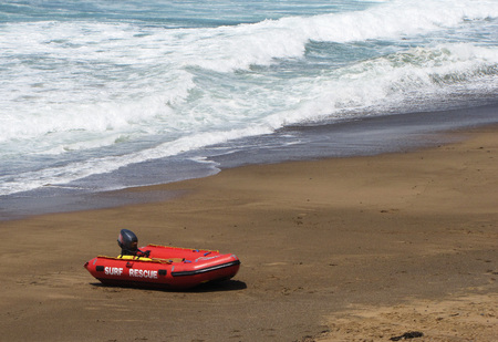 A rescue boat on the beach ready for an emergency.