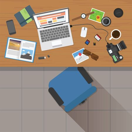 Top view of photographer working desk with stuff and laptop