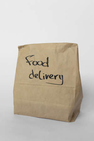 Craft bag with food delivery on a white background Imagens