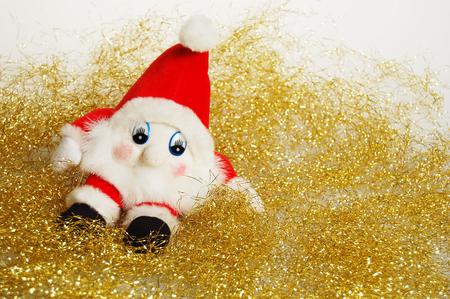 Toy dwarf with Christmas decoration.