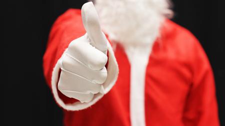 Santa showing thumbs up.