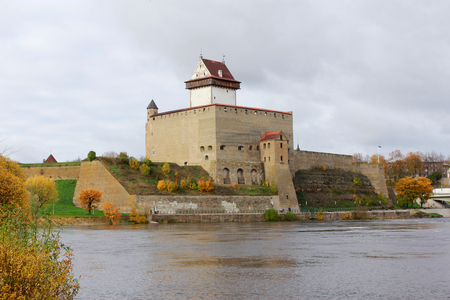 Narva Castle in Autumn by the Bank of the River