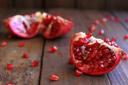 Pomegranate Pieces Scattered on Wooden Background