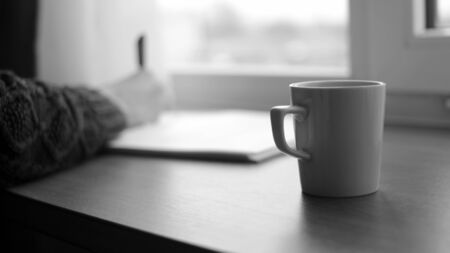 Writer in a Hotel Room Working on Novel with a Cup of Coffee