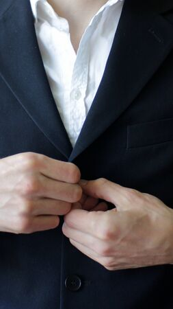 Businessman Closing Button on a Suit Close Up