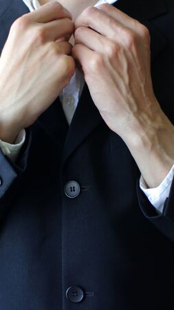 Businessman in Suit Closing Button on a Shirt. Business and modern lifestyle concept photo. 版權商用圖片