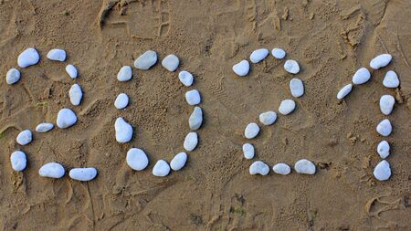2021 New Year Written with Stones on Sea Shore