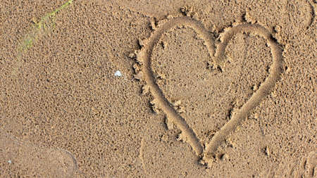 Heart Figure Drawn on a Sea Sand
