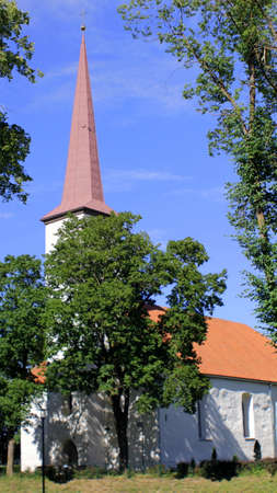 Medieval Church in Small Rural Town on Sunny Day