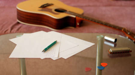Acoustic Folk Guitar with Song Notes and Harmonica