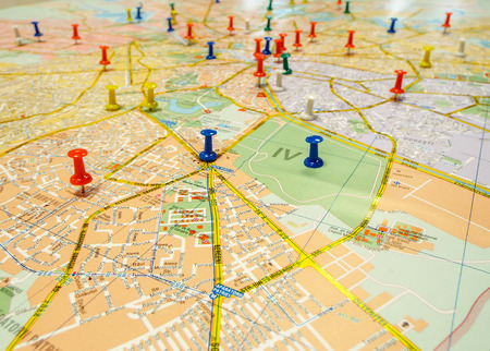 pushpins: Pushpins marking locations on a road map Stock Photo