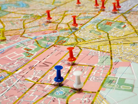 pinpoint: Blue pushpin marking a location on a road map