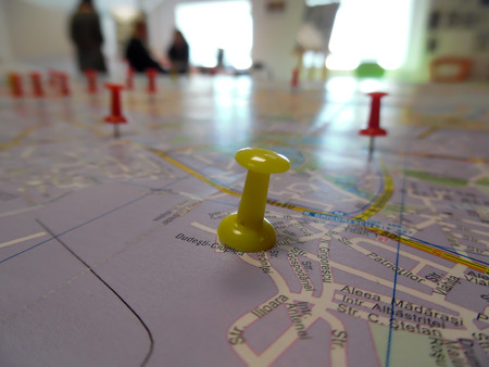Pushpin marking a location on a road map photo
