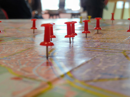 locations: Pushpins marking locations on a road map Stock Photo