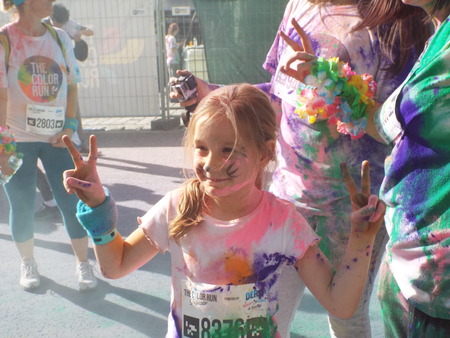 crowded space: The Color Run. Close-up of marathon, people covered with colored powder.